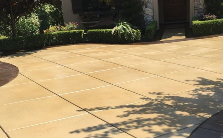 driveway with custom concrete stain and stamp pattern concrete