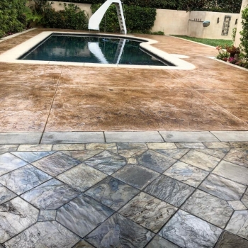 Residential custom waterproof pool with Life Deck 20 series stain